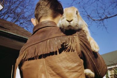 Boy Carrying Rabbit by William P. Gottlieb