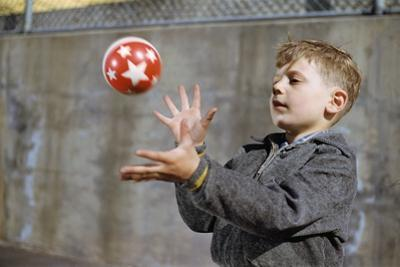Boy Catching a Ball by William P. Gottlieb