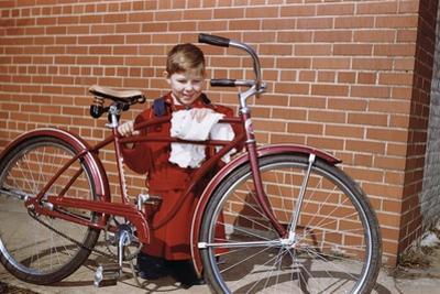 Boy Cleaning His Bike by William P. Gottlieb