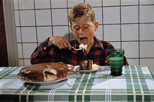 Boy Eating a Slice of Cake by William P. Gottlieb