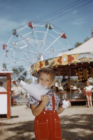 Boy Eating Cotton Candy at Fair by William P. Gottlieb