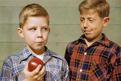 Boy Eying His Brother's Apple by William P. Gottlieb