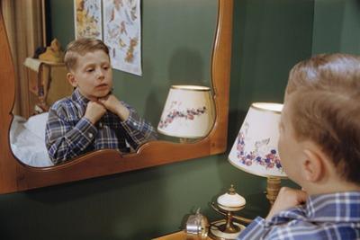 Boy Getting Dressed by William P. Gottlieb