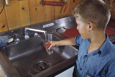 Boy Getting Glass of Tap Water by William P. Gottlieb