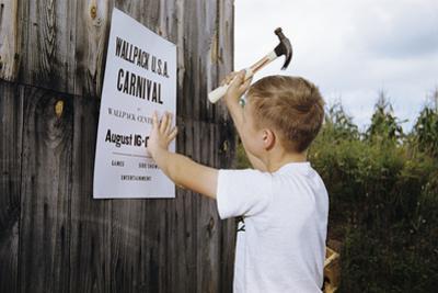 Boy Hammering Fair Sign by William P. Gottlieb