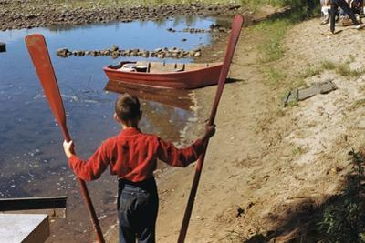 Boy Holding Oars by William P. Gottlieb