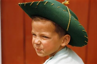 Boy in Cowboy Hat Making Funny Face