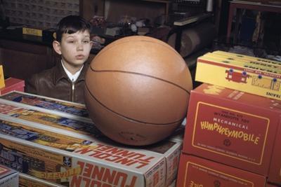 Boy Longing for Basketball by William P. Gottlieb