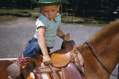 Boy Mounting Horse by William P. Gottlieb
