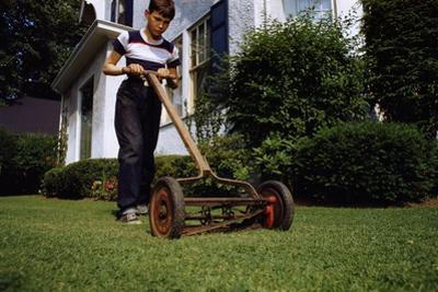 Boy Mowing Lawn by William P. Gottlieb