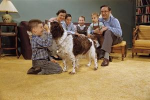 Boy Playing with the Family Dog by William P. Gottlieb
