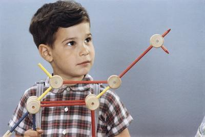 Boy Playing with Tinkertoys by William P. Gottlieb