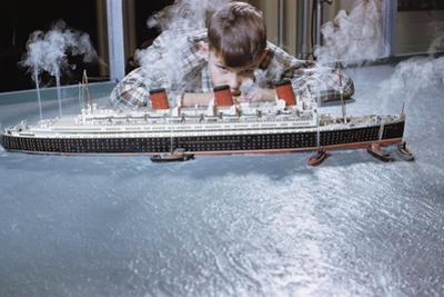 Boy Playing with Toy Ocean Liner by William P. Gottlieb