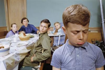 Boy Pouting Near the Dinner Table by William P. Gottlieb