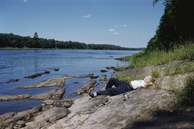 Boy Relaxing by the Delaware River by William P. Gottlieb