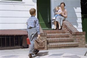 Boy Returning from School by William P. Gottlieb