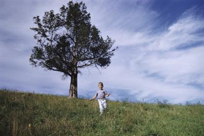 Boy Running Down Hill by William P. Gottlieb