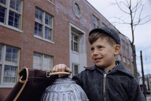 Boy Standing in Schoolyard by William P. Gottlieb