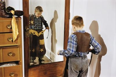 Boy Trying on Cowboy Duds by William P. Gottlieb