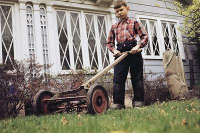 Boy Unhappily Mowing Lawn by William P. Gottlieb
