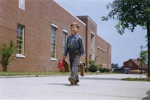 Boy Walking to School by William P. Gottlieb