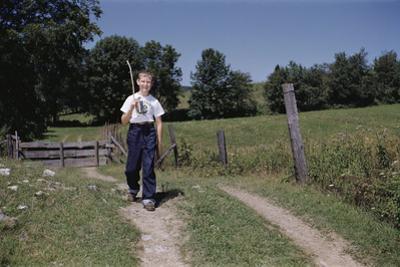 Boy Walking with Fishing Pole by William P. Gottlieb