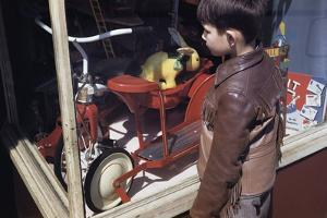 Boy Window Shopping at a Toystore by William P. Gottlieb