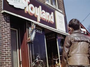 Boy Windowshopping at Toyland by William P. Gottlieb