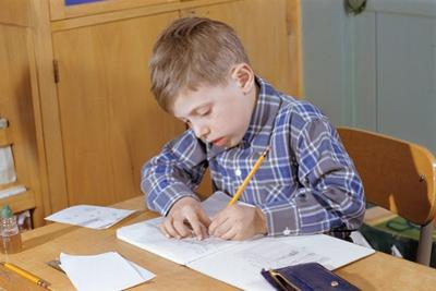 Boy Working on His Schoolwork by William P. Gottlieb
