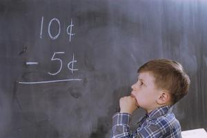 Boy Working on Subtraction Problem by William P. Gottlieb