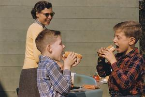 Boys Eating Hot Dogs by William P. Gottlieb