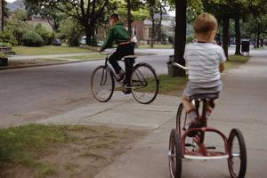Boys Riding their Bike and Tricycle by William P. Gottlieb