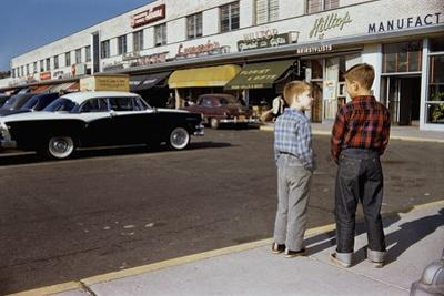 Boys Standing Alongside Strip Mall Parking Lot by William P. Gottlieb