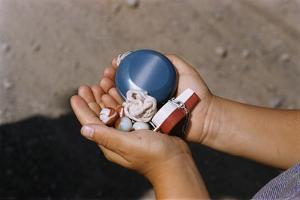 Child Holding Toys by William P. Gottlieb
