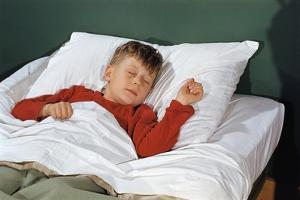 Child Sleeping in Bed by William P. Gottlieb