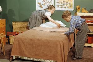 Children Making a Bed by William P. Gottlieb