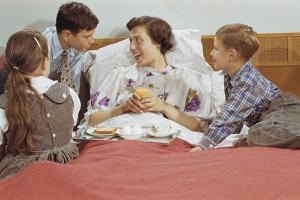 Children Serving Mother Breakfast in Bed by William P. Gottlieb