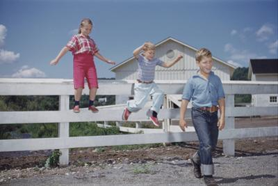 Children Walking Away from Fence by William P. Gottlieb