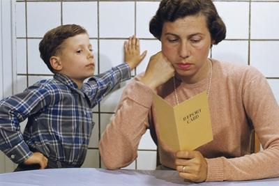 Disappointed Mother Reading Son's Report Card by William P. Gottlieb