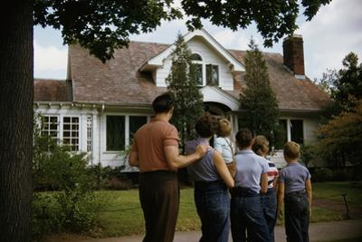 Family Admiring Home by William P. Gottlieb