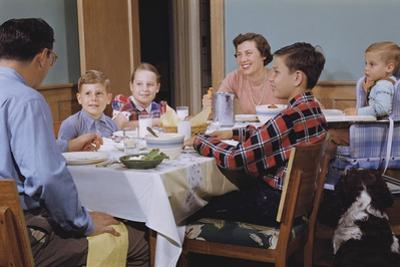 Family Eating at the Dinner Table by William P. Gottlieb