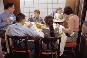 Family Eating Together at Dinner Table by William P. Gottlieb