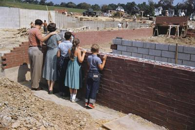 Family Observing a School Construction Site by William P. Gottlieb