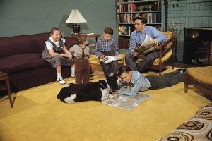 Family Sitting around Living Room by William P. Gottlieb