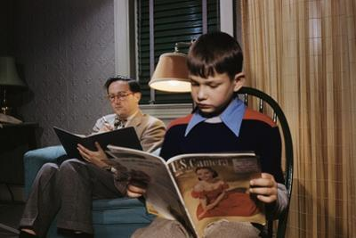Father and Son Reading at Home by William P. Gottlieb