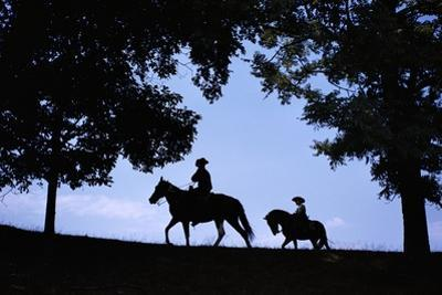 Father and Son Riding Horses by William P. Gottlieb