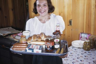 Girl Carrying Tray of Barbecue Items by William P. Gottlieb