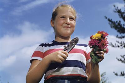 Girl Holding Cut Flowers by William P. Gottlieb