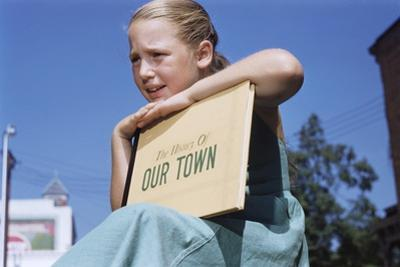 Girl Holding Town History Book by William P. Gottlieb