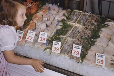 Girl Looking at Seafood Display by William P. Gottlieb